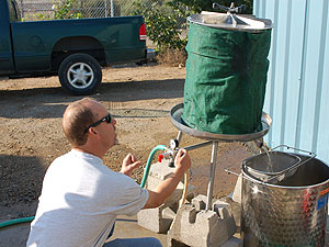 Using hydraulic pressure to squeeze the grapes.