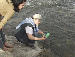 Taking samples from the Truckee River in downtown Reno, Nevada