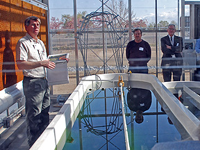 Dr. Cushman demonstrating race track for growing algae.