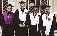 Deans David Thawley, middle left, and Rang Narayanan, middle right.