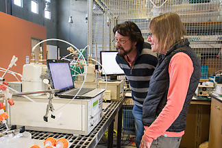 Mae Gustin (right) and visiting scientist comparing results produced by different types of equipment.