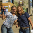 two women at Nevada Field Day giving a thumbs up