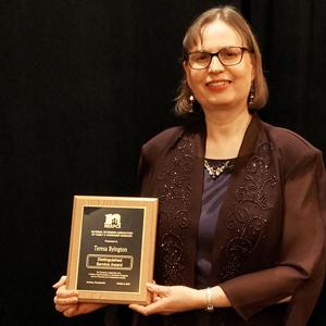 Teresa Byington with her award plaque