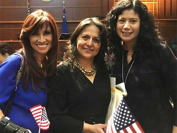 Lizeth Ramirez-Barroeta with her colleagues at her naturalization ceremony