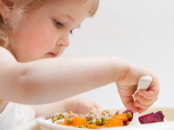 eating her vegetables