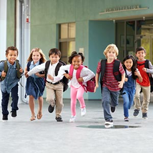 school kids running to class