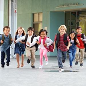 school kids running to class