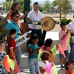 kids dancing at outdoor concert