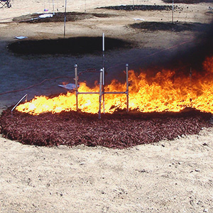 A pile of mulch burns in a controlled experiment