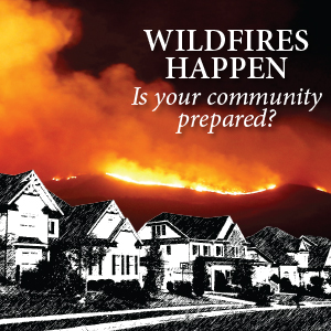 A row of black and white houses with a wildfire approaching in the background. Text saying: Wildfires Happen. Is your community prepared?