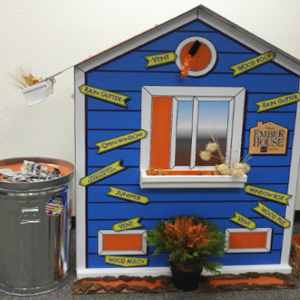 An Ember House structure with ember vulnerabilities highlighted in orange. A trashcan adjacent to the Ember House.