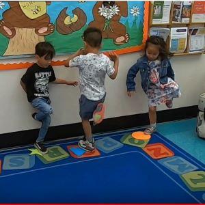 Kids hopping on a circle.