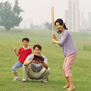 A family playing baseball together.