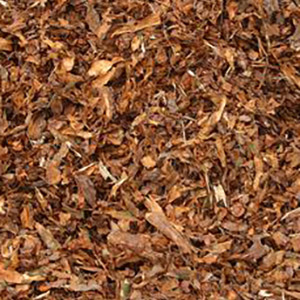 Shredded wood or bark can be a useful organic mulch.