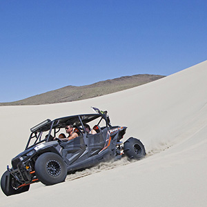 People riding in ATV on Sand Mountain