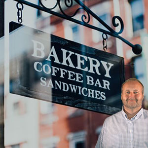 Bakery sign that says coffee bar and sandwiches with Mike Bindrup