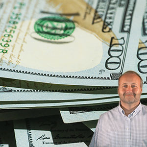 Several $100 bill with Mike Bindrup