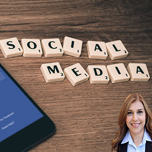 Scrabble tiles spelling out Social Media with Reyna Mendez