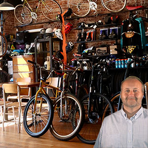 Bicycle shop with lot of bikes and Mike Bindrup