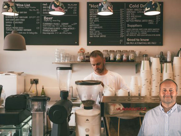 Small business with man standing behind counter with Mike Bindrup