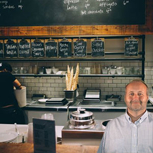 Business with chalk board menu and Mike Bindrup