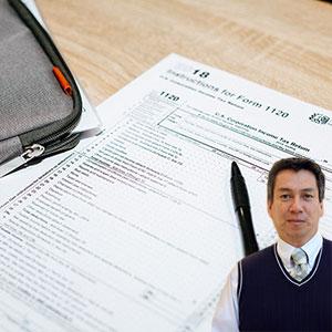 Tax forms and pen and Juan Salas