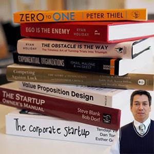 Stack of start up books and Juan Salas