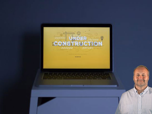 Computer that says under construction with Mike Bindrup