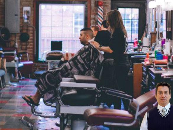 Barber shop with lady cutting a man's hair with Juan Salas