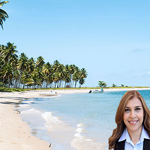 Beach with palm trees and white sands with Reyna Mendez