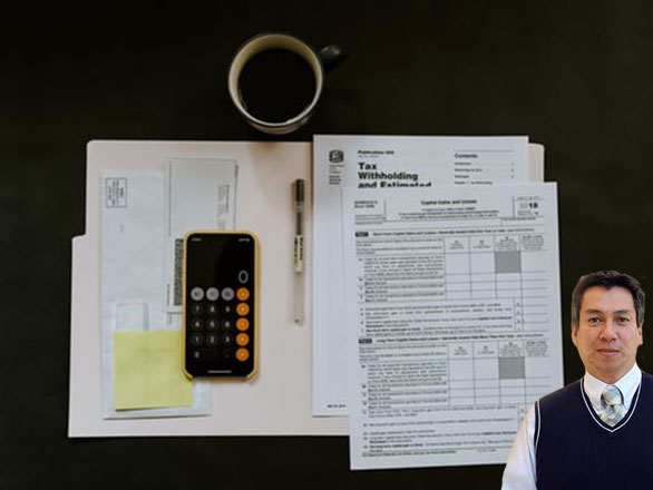 Several tax forms and cup of coffee with Juan Salas