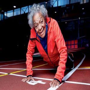 An older woman doing push-ups