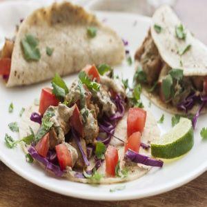 A plate of seasoned fish tacos.