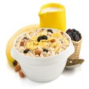 A bowl of oatmeal with fruit and nuts.