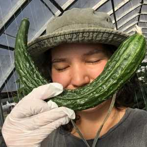 noelle smiling with a cucumber