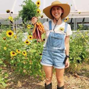 jen in sunflowers holding carrots