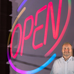 Neon open sign with Mike Bindrup