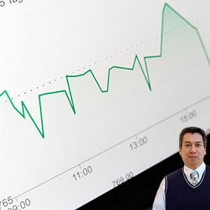 Computer with graph and Juan Salas