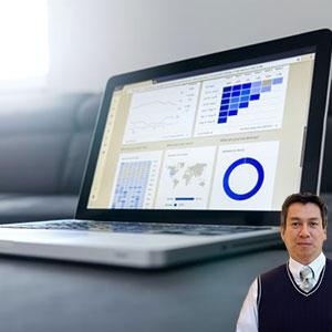 Computer laptop with charts displayed with Juan Salas
