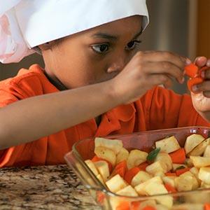 a boy peeling grapes