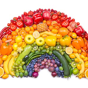 fruits and vegetables arranged in a rainbow