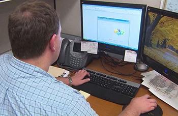 Man typing on keyboard at his desk