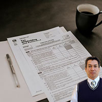 Several tax form, cup of coffee and Juan Salas