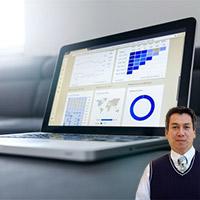 Computer with graphs and Juan Salas