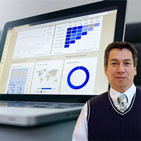 Computer with several graphs and data with Juan Salas