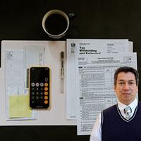 Tax forms, calculator and Juan Salas