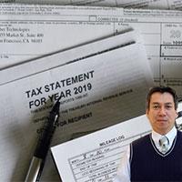 Several tax forms and Juan Salas