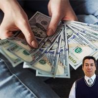 Hand holding $100 dollar bills and Juan Salas
