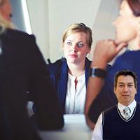 Woman being interview and Juan Salas