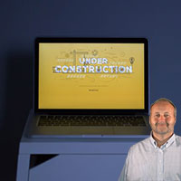 Computer with website under construction with Mike Bindrup
